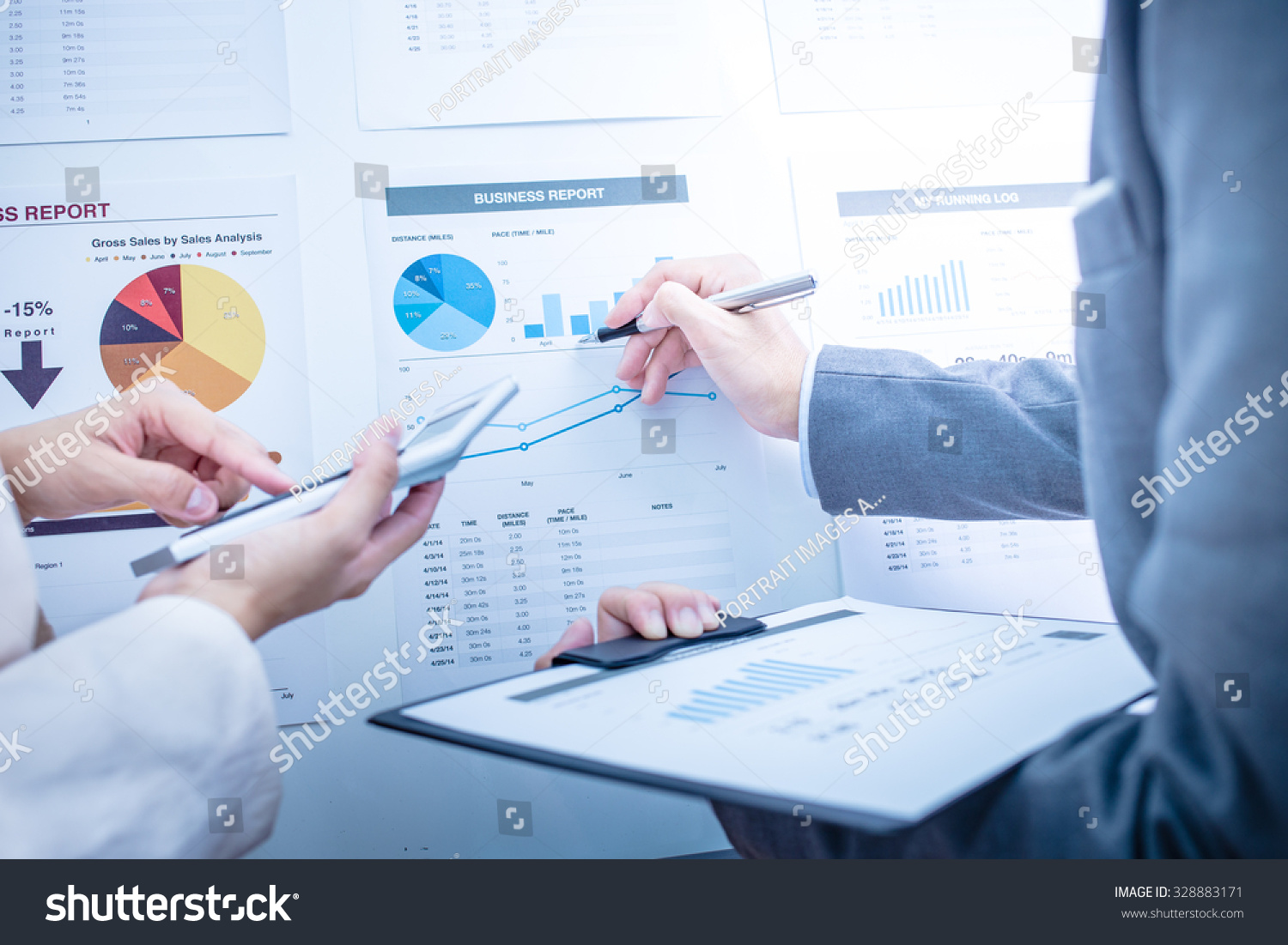 stock-photo-business-people-discussing-the-charts-and-graphs-showing-the-results-of-their-successful-teamwork-328883171