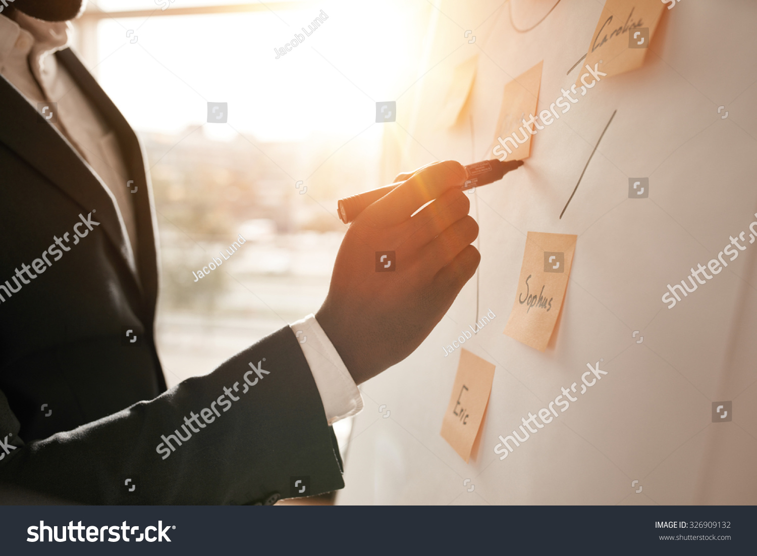 stock-photo-cropped-shot-of-businessman-putting-his-ideas-on-white-board-during-a-presentation-in-conference-326909132