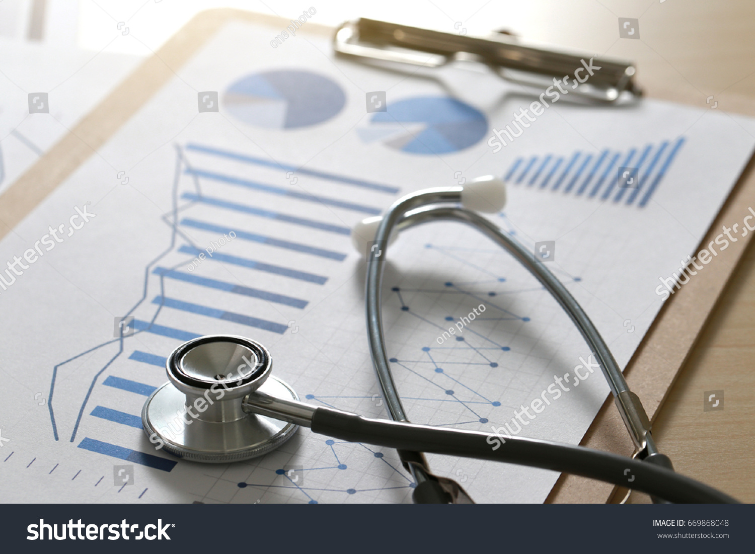 stock-photo-financial-report-chart-and-calculator-medical-report-and-stethoscope-669868048